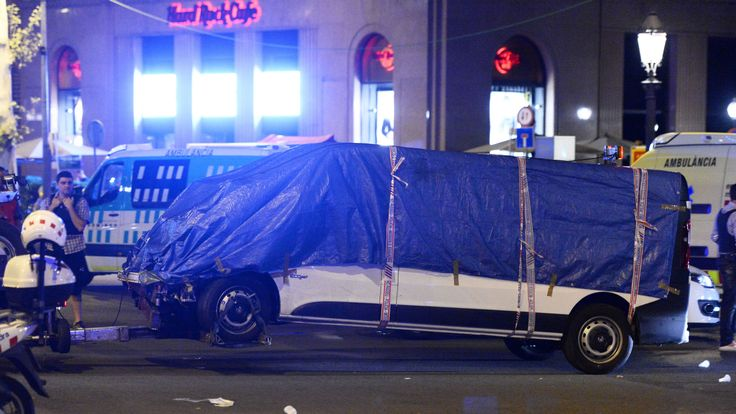 The van who ploughed into the crowd, killing at least 13 people and injuring around 100 others is towed away from the Rambla in Barcelona