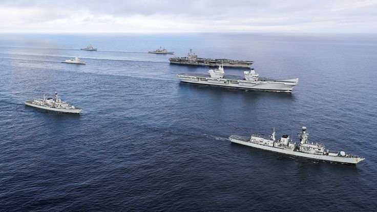 HMS Elizabeth (second from right) sails with the USS George HW Bush and her carrier strike group