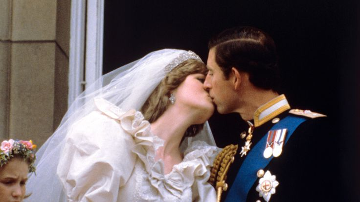 July 1981: The newly married Prince and Princess of Wales kiss on the balcony of Buckingham Palace after their wedding ceremony at St. Paul's cathedral