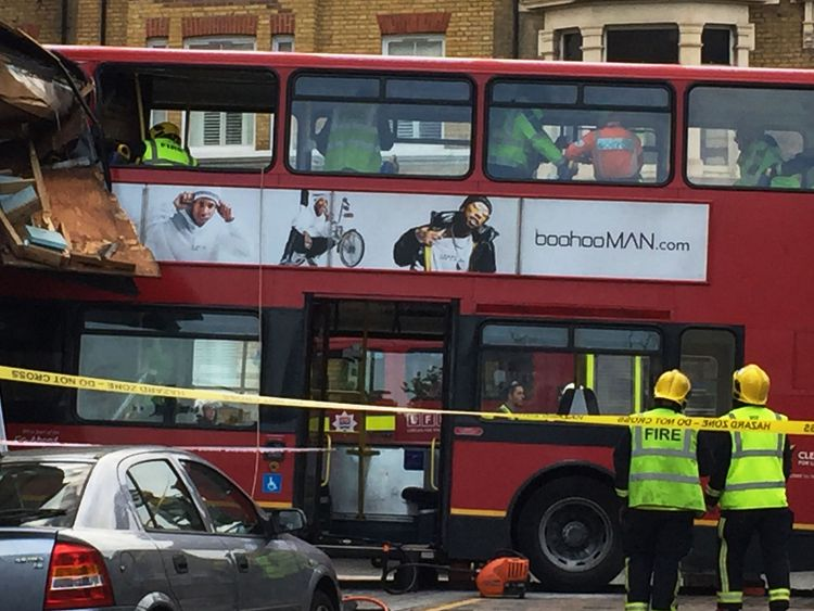 Emergency services at the scene in Lavender Hill on 10 August 2017, after a double-decker bus crashed into a store on the high street, near Clapham Junction