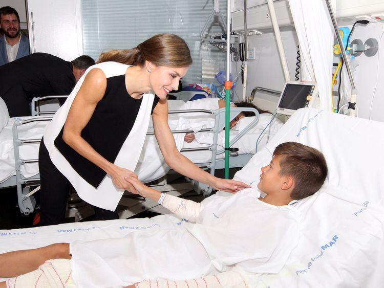 Spain's Queen Letizia visits victims