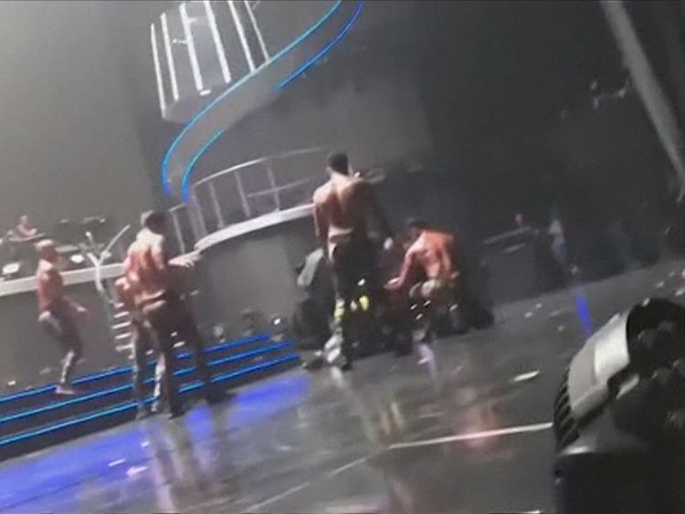 Britney Spears' dancers pinned the man down before security staff joined the struggle