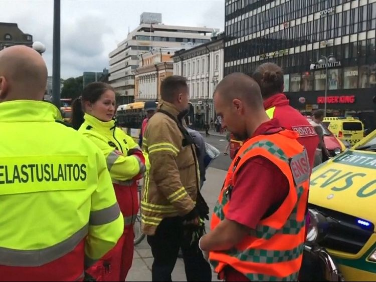 Emergency service workers at the scene of a stabbing in Finland