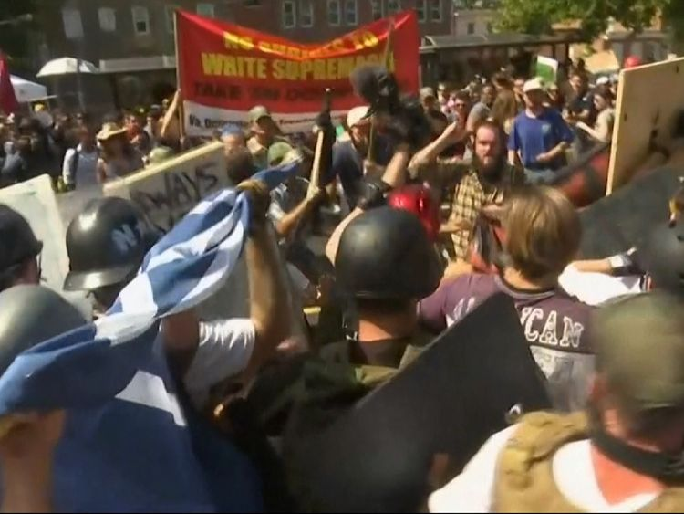 A man was seen brandishing a stick as many in the crowd wore helmets as the two sides clashed