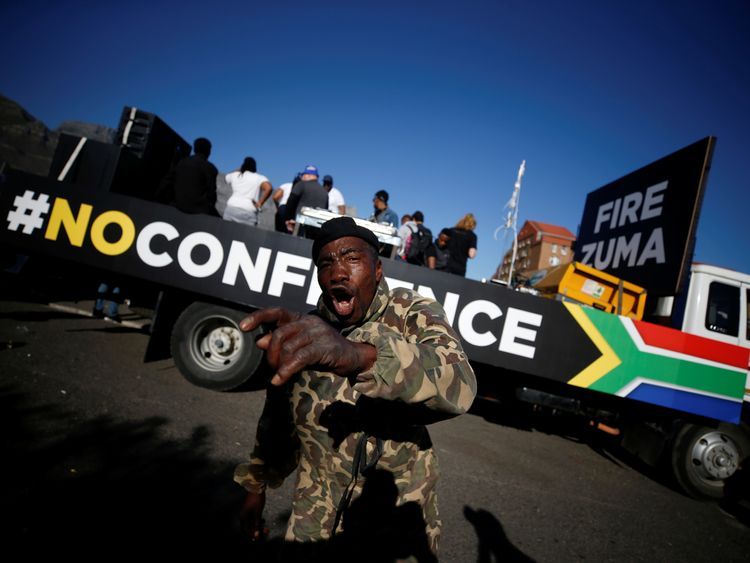 Anti-Zuma protesters march ahead of the vote of no confidence against President Jacob Zuma