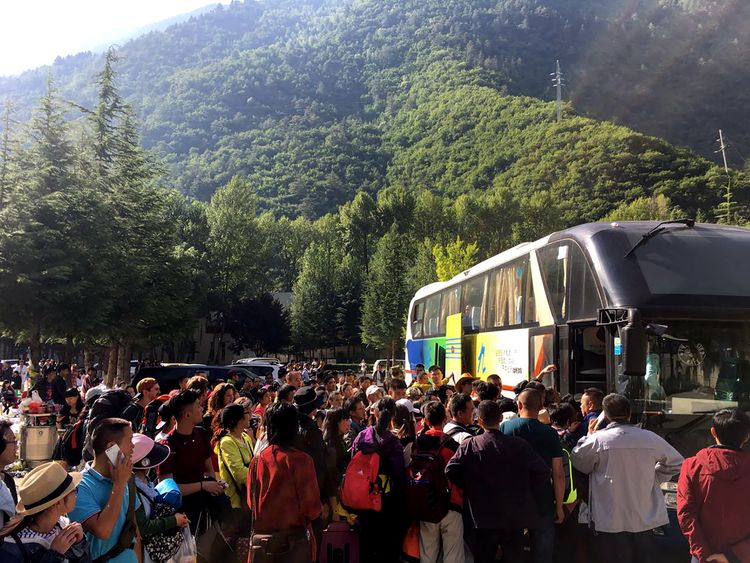 Tourists wait to be evacuated after an earthquake in China's Sichuan province