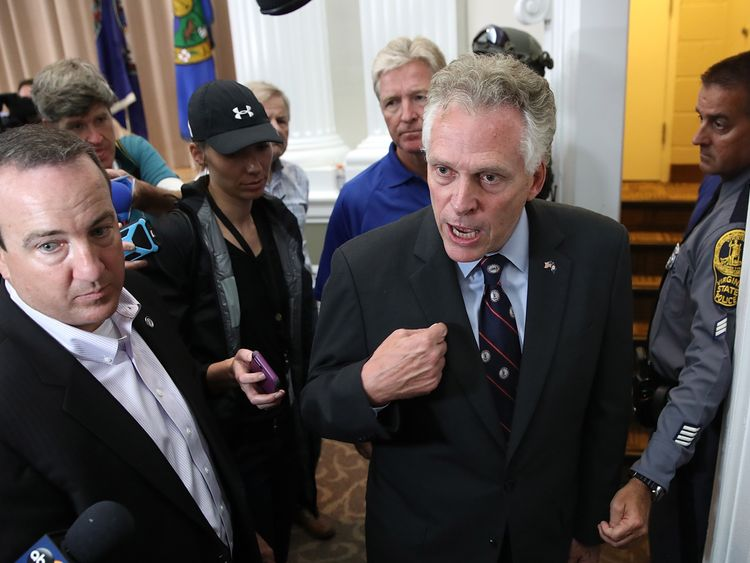 Virginia Gov. Terry McAuliffe (R) speaks following prepared remarks at a press conference August 12, 2017 in Charlottesville, Virginia