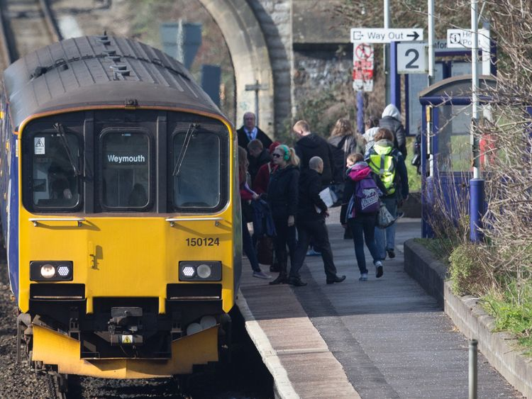BATH, ENGLAND - FEBRUARY 19: A Weymouth bound train stops at Oldfield Park station as it approaches Bath Spa station on the Great Western railway line on February 19, 2016 in Bath, England.