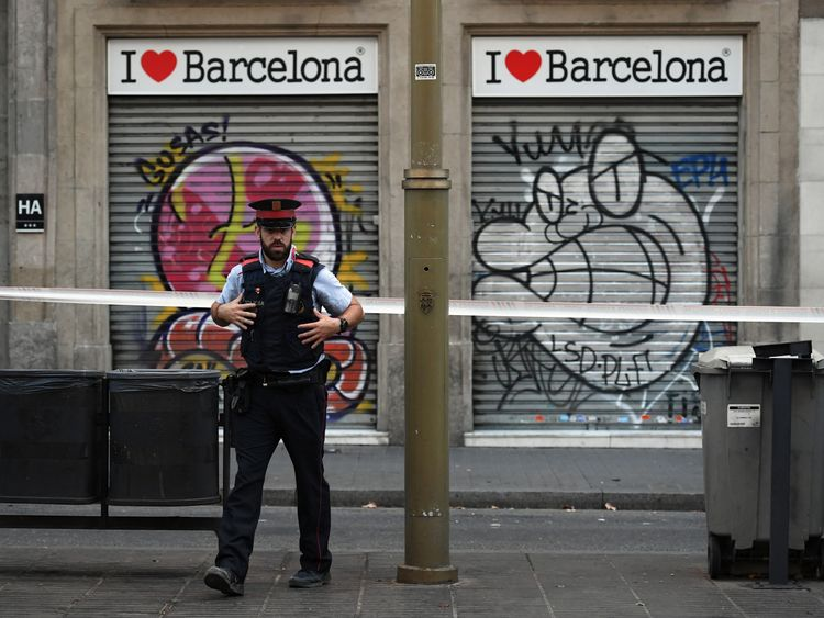 A police officer patrols on Las Ramblas following the terror attack