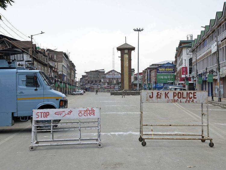 An Indian armoured vehicle blocks a street during a strike in the Kashmiri city of Srinagar on Independence Day