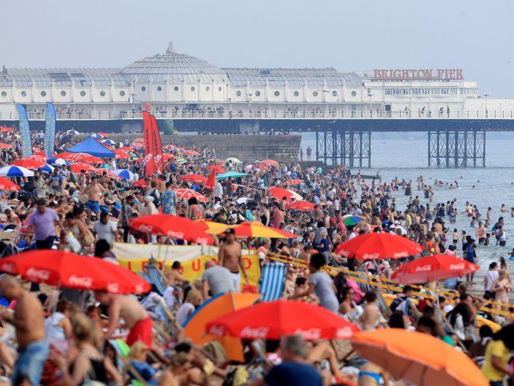 Sunbathers enjoy the heat on Brighton beach