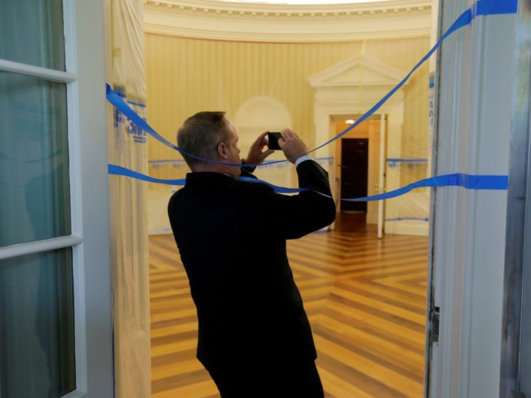 WASHINGTON, DC - AUGUST 11: The Oval Office sits empty and the walls covered with plastic sheeting during renovation work at the White House August 11, 2017 in Washington, DC. SEAN SPICER takes a picture.