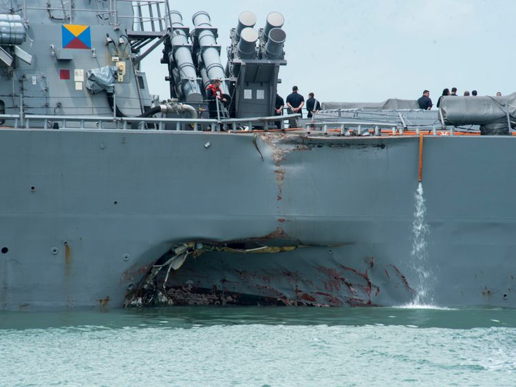 Damage to the ship's port side is clearly visible. Pic: US Navy