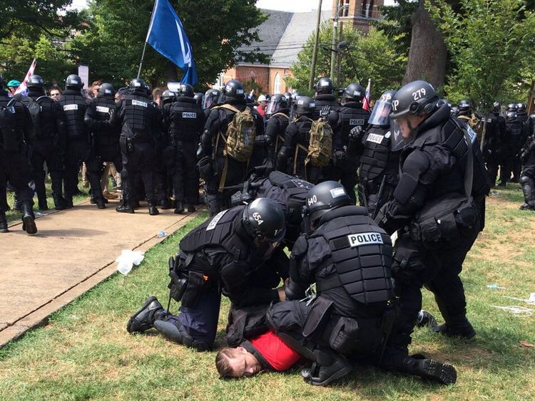 Police arrest one of the activists in Charlottesville. Pic: Virginia State Police