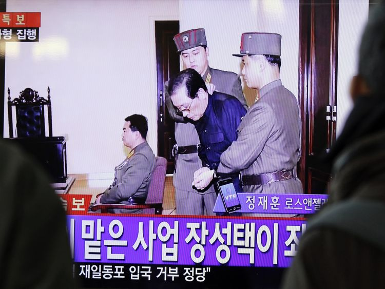 Jang Song Thaek is led away by guards prior to his execution