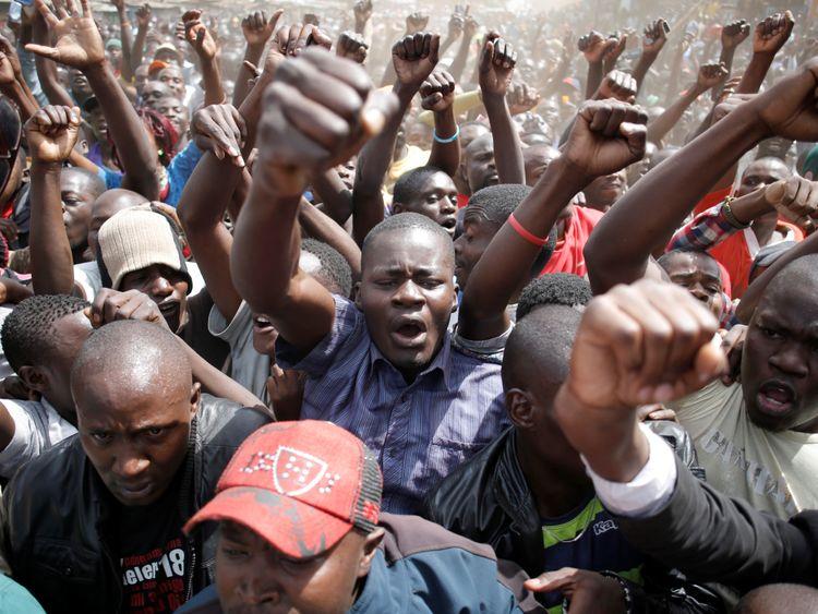 Supporters of Raila Odinga shout during a rally in Nairobi's Kibera slum