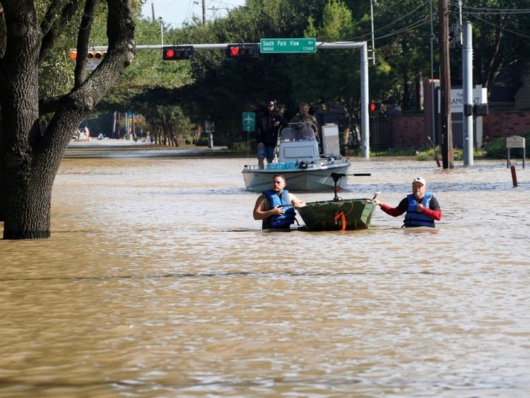 Volunteers with boats look for victims in Houston