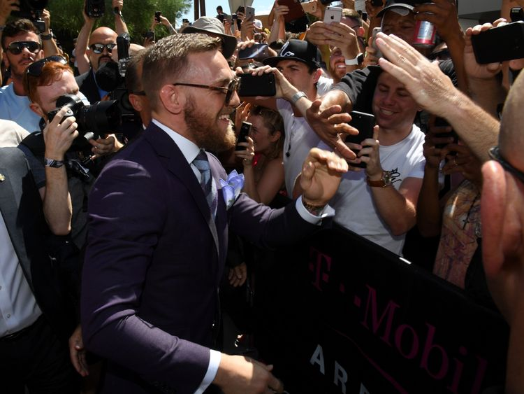 LAS VEGAS, NV - AUGUST 22:  UFC lightweight champion Conor McGregor greets fans as he arrives at Toshiba Plaza on August 22, 2017 in Las Vegas, Nevada. McG