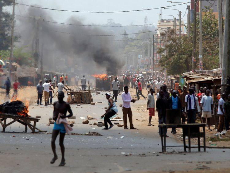 Demonstrators protesting the election results set barricades on fire in Kisumu