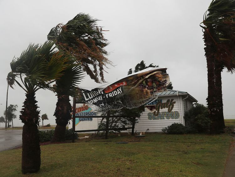 A sign blows in the wind in Corpus Christi, Texas