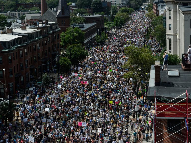 A large crowd of people march towards the Boston Commons to protest the Boston Free Speech Rally in Boston,...