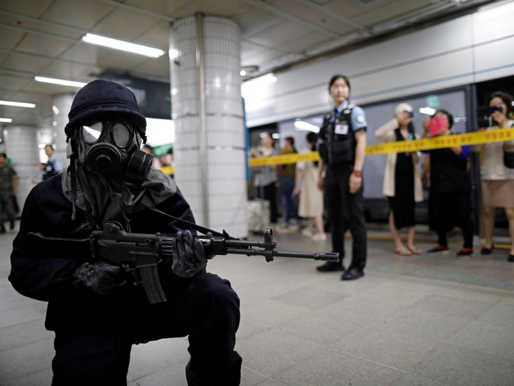 A South Korean policeman takes part in an anti-terror drill as part of the Ulchi Freedom Guardian exercise...