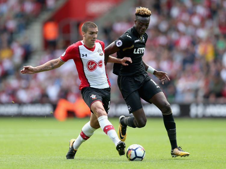 Oriol Romeu of Southampton and Tammy Abraham of Swansea City battle for possession during the Premier League