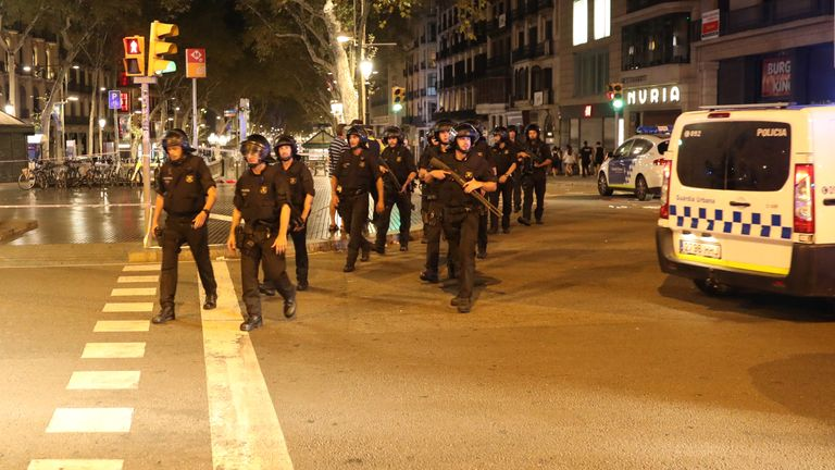 Armed Catalonian Mosses de Escuadra officers leave the area where a van crashed into pedestrians at Las Ramblas in Barcelona, Spain, August 18, 2017