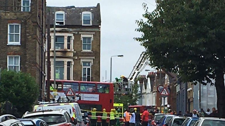 A double-decker bus has crashed into a shop on a busy London high street, Lavender Hill, near Clapham Junction train station in southwest London