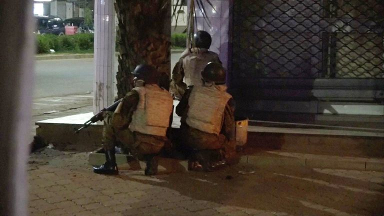 Soldiers surround a restaurant following an attack by gunmen on the restaurant in Ouagadougou, Burkina Faso, in this still frame taken from video August 13, 2017