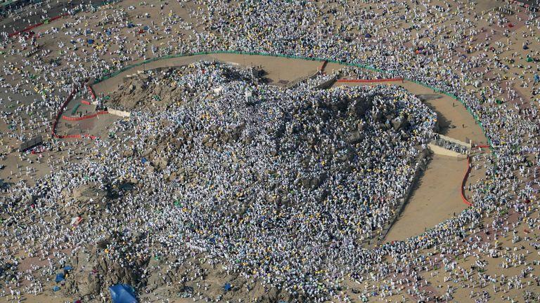 Muslim pilgrims gathering on Mount Arafat