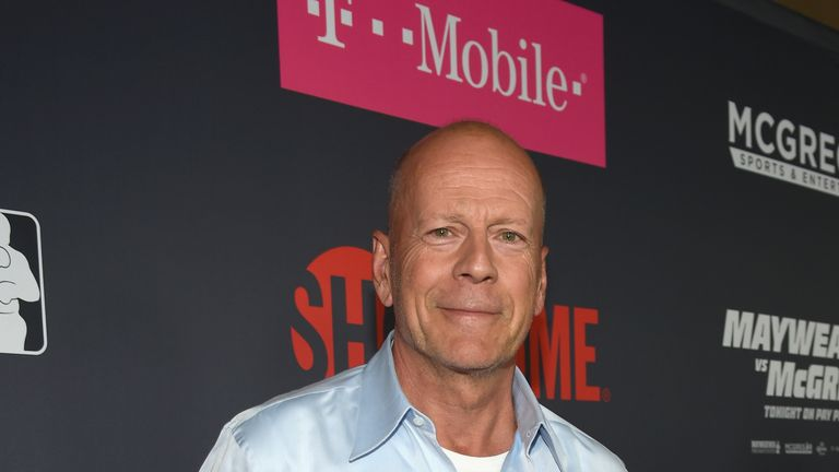 Actor Bruce Willis walks the red carpet ahead of the showdown