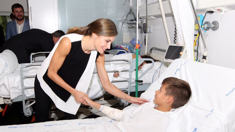 Spain's Queen Letizia visits victims