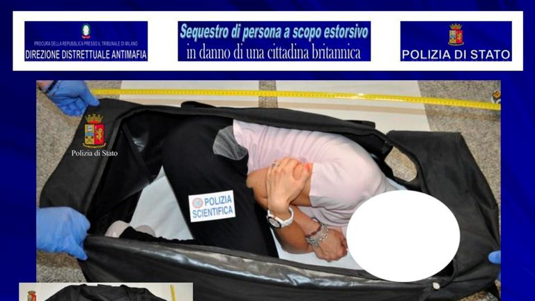A person taking part in a reenactment by Italian police shows how a kidnapped British model was kept in a bag, in this handout picture provided by the Italian Police in Milan on August 5, 2017. Polizia Di Stato/Handout via REUTERS ATTENTION EDITORS - THIS IMAGE WAS PROVIDED BY A THIRD PARTY. PICTURE WAS MASKED AT SOURCE