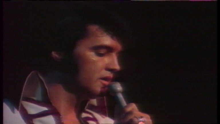 Elvis singing on stage.