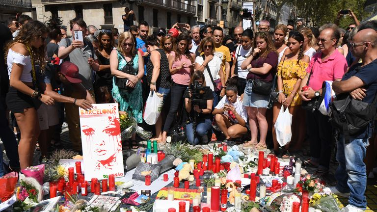 Flowers and candles are left by mourners on the Las Ramblas boulevard