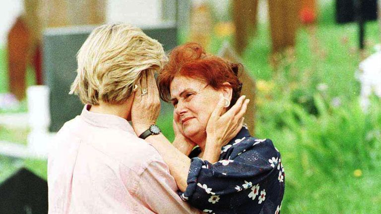 Aug 1997: Diana comforts a woman during a visit to Sarajevo's Lion cemetery on one of her last engagements highlighting the suffering of landmine victims
