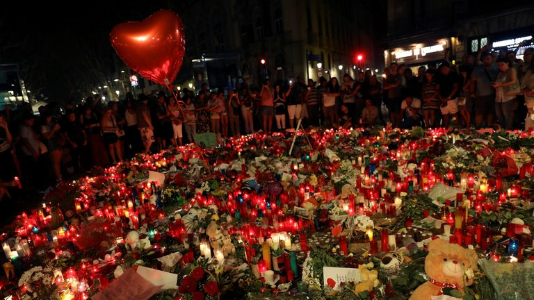 People gather at an impromptu memorial where a van crashed into pedestrians at Las Ramblas in Barcelona, Spain, August 19, 2017
