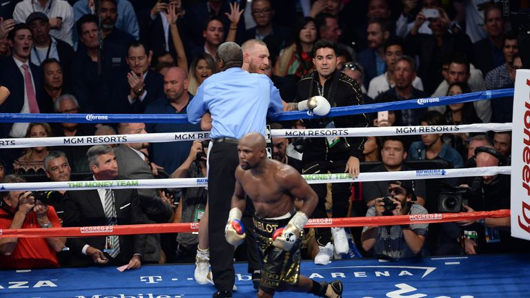 Mayweather celebrates after the referee stops the fight in the 10th round