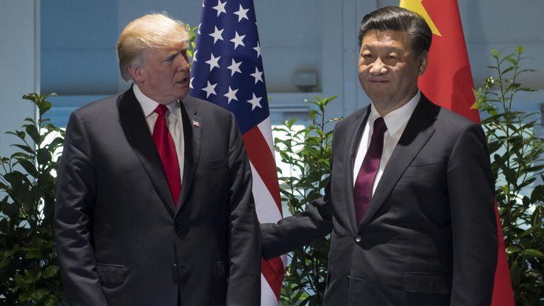 US President Donald Trump and Chinese President Xi Jinping (R) pose prior to a meeting on the sidelines of the G20 Summit