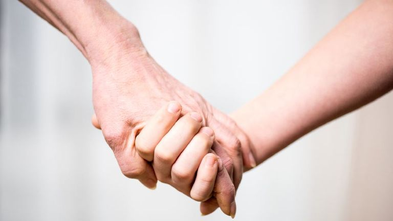 Grandmother and child holding hands. Pic: File
