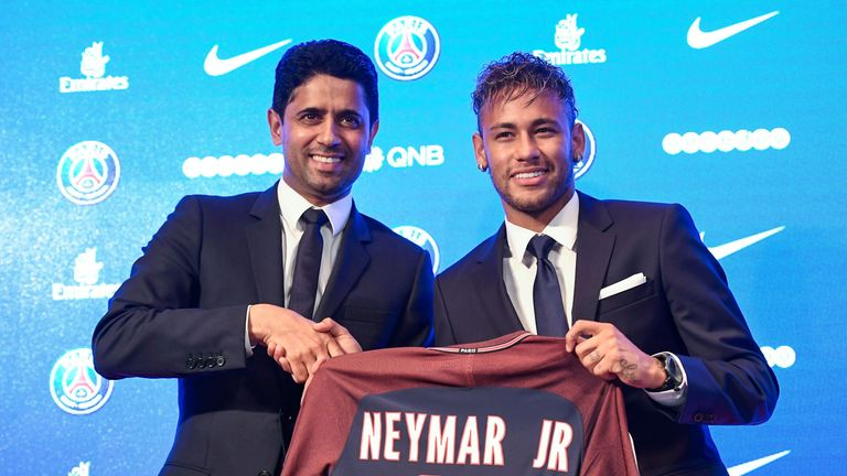 Neymar (R) and PSG president Nasser Al-Khelaifi after he completed his move to the club from Barcelona