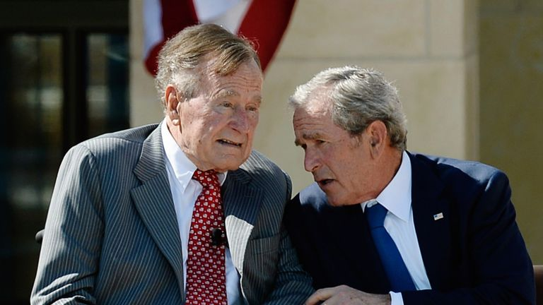 The father and son presidents pictured together in 2013