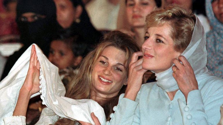 Feb 1996: Diana pulls on her head scarf as her friend Jemima Goldsmith does the same at the Shaukat Khanum Memorial Cancer Hospital in Lahore, Pakistan