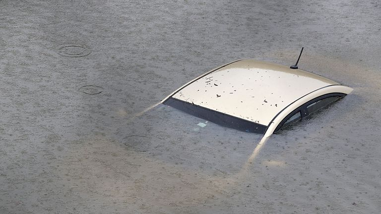 A car is submerged by floodwater on Interstate 610 North as low-lying Houston battles with Tropical Storm Harvey