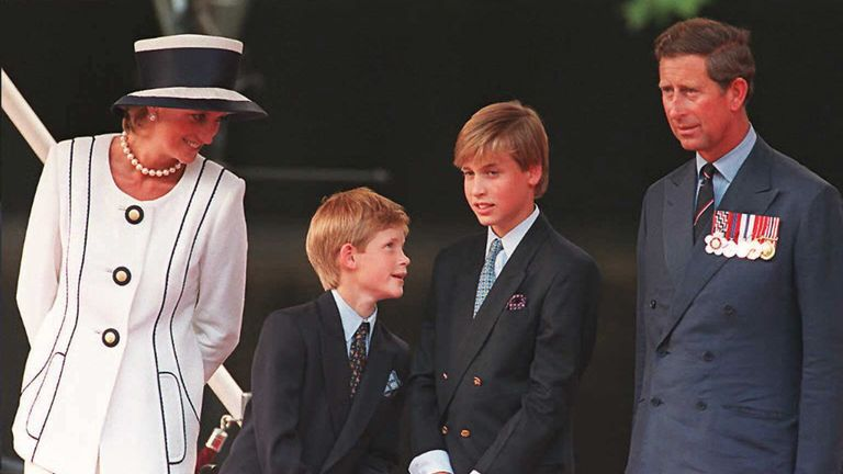 Aug 1995: Diana, Harry, William and Charles watch the parade march past as part of the commemorations of VJ Day in London