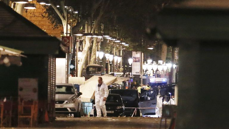 Forensic policemen in the cordoned off area of Las Ramblas