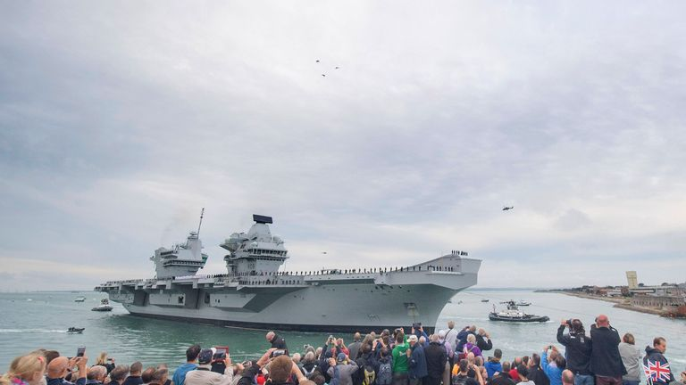 Dozens of spectators lined Portsmouth Harbour to witness HMS Queen Elizabeth's arrival