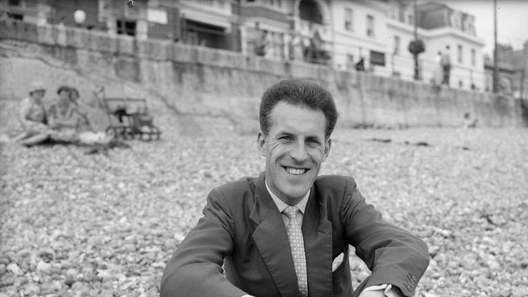 Sitting on a beach in 1958