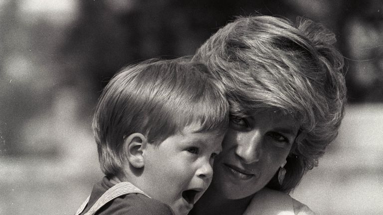 Aug 1988: Prince Harry yawns as his mother holds him during a morning picture session at Marivent Palace as guests of King Juan Carlos and Queen Sofia in Mallorca